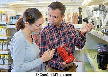 Couple shopping for a coffee maker