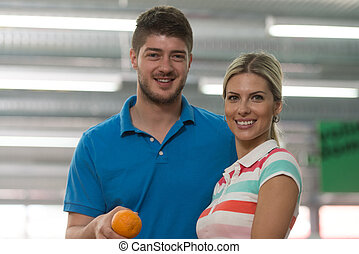 Couple Shopping For Fruits And Vegetables - Beautiful Young...