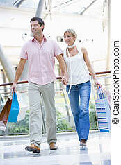 Couple shopping in mall