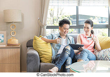 Couple shopping online at home