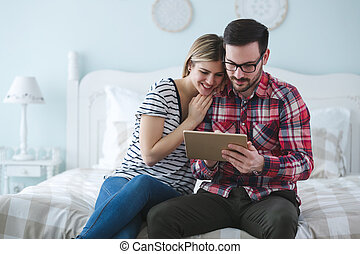 Couple shopping online using tablet
