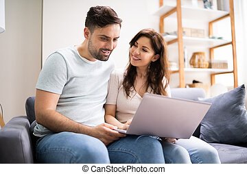Couple Shopping Online. Woman Buying