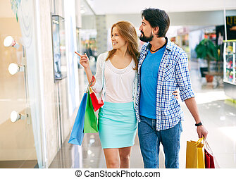 Couple shopping - Portrait of young couple shopping in the...