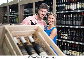 Couple Shopping Wine - Beautiful Young Couple Shopping For...