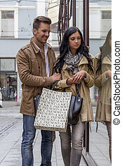 couple shopping - young couple on shopping tour. shopping in...