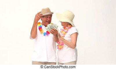 Couple showing off their money isolated on a white background