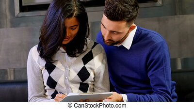 Couple signing agreement in office 4k