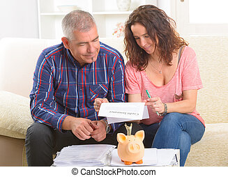 Couple signing credit insurance contract