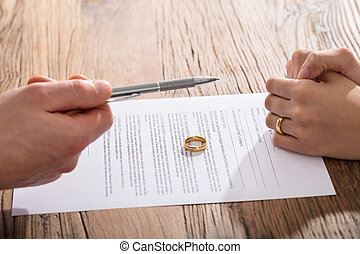 Couple Signing Divorce Paper