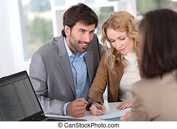Couple signing property contract