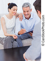 Couple signing salesman contract