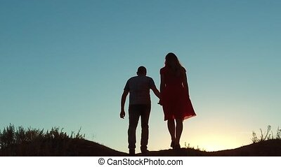 couple silhouette walking kiss love holding hand toward the...