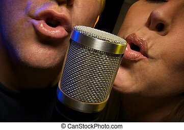 Couple Singing Duet at Condenser Microphone.