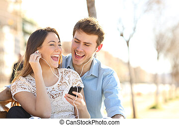 Couple singing together listening to music