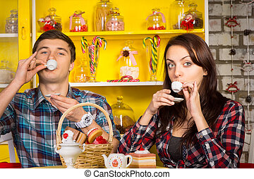 Couple Sipping a Drink From Small Cups at the Cafe - Close ...