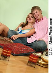 couple sit on pillow