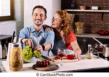 Couple sitting and cooking at table