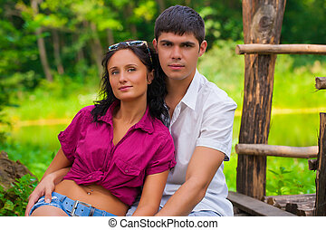 couple sitting and looking at camera