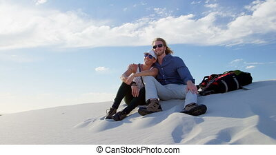 Couple sitting and talking in the desert 4k - Romantic...
