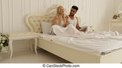 Couple Sitting bed dancing mix race man woman playing having fun together bedroom