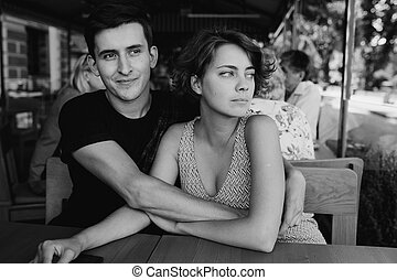 couple sitting in a cafe outside