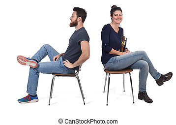 couple sitting in a vintage chair isolated on white