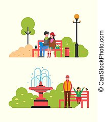 Couple Sitting in Autumn Park on Bench with Notebook