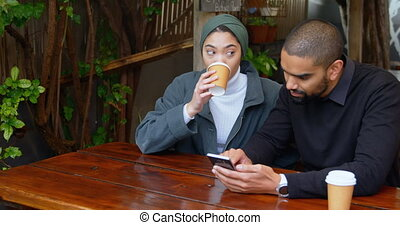 Couple sitting in cafeteria 4k