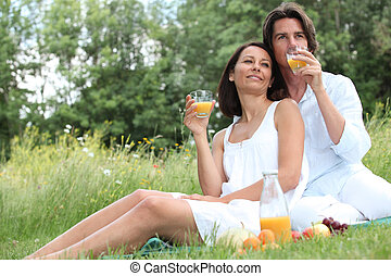 couple sitting in high grass