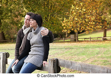 Couple sitting in the countryside