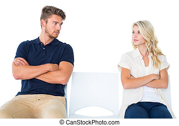 Couple sitting not talking - Young couple sitting in chairs...