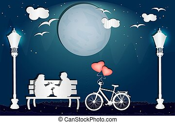 Couple sitting on a bench in the park in love atmosphere.