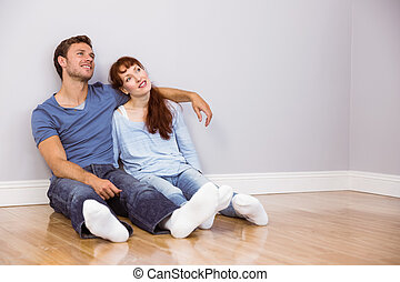 Couple sitting on floor together