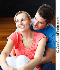 Couple sitting on the floor