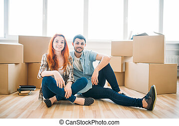 Couple sitting on the floor, moving to new house