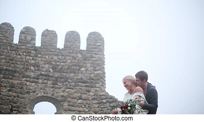 Couple sitting on the roof of old building
