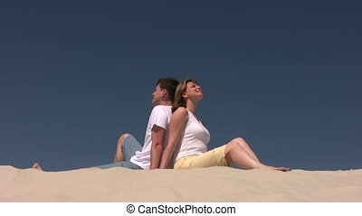 Couple sitting on the sand