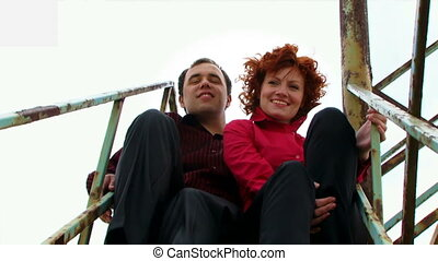 Couple sitting on the stairs