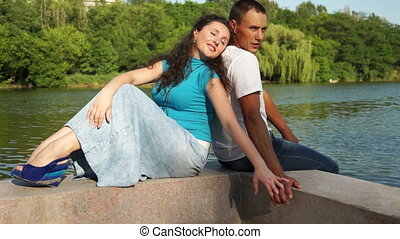 Couple sitting on the waterfront