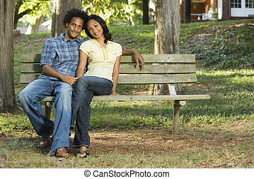 Couple sitting together.