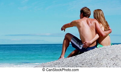 Couple sitting while hugging each other