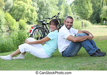 Couple sitting with bicycles