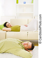 Couple sleeping at home