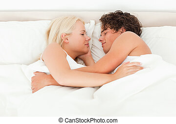 Couple sleeping facing each other