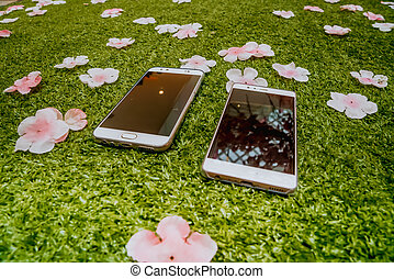 Couple smartphone on the ground
