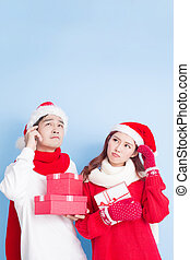 couple smile with merry christmas