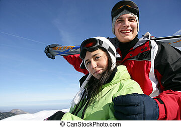 Couple snowboarding