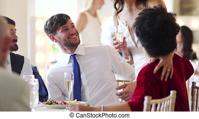 Couple Socialising At Their Wedding - Bride and groom...