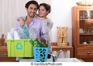 Couple sorting the recycling