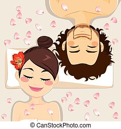 Couple Spa Treatment - Couple on spa having relaxing flower...